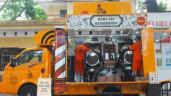 Tiệm cắt tóc trên ô tô tải phục vụ sinh viên giá 2.000 đồng