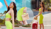 Không phải hàng hiệu, Khánh Vân xách túi giá rẻ tại Miss Universe mà đẳng cấp hơn người