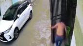 Bị cổng sắt đổ vào người, tài xế có hành động đáng khen ngợi
