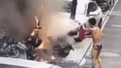 Xe đạp điện phát nổ, nam thanh niên cởi trần lao ra dập lửa