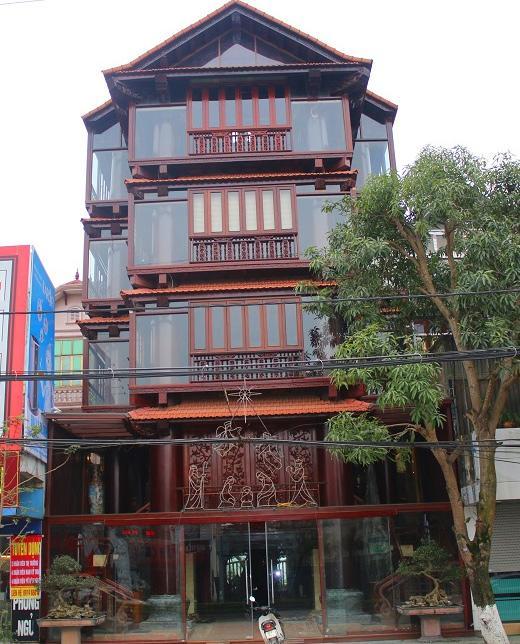 """Choáng ngợp trước căn nhà 5 tầng làm hoàn toàn bằng gỗ quý """"độc nhất vô nhị"""" ở Hà Tĩnh - 1"""
