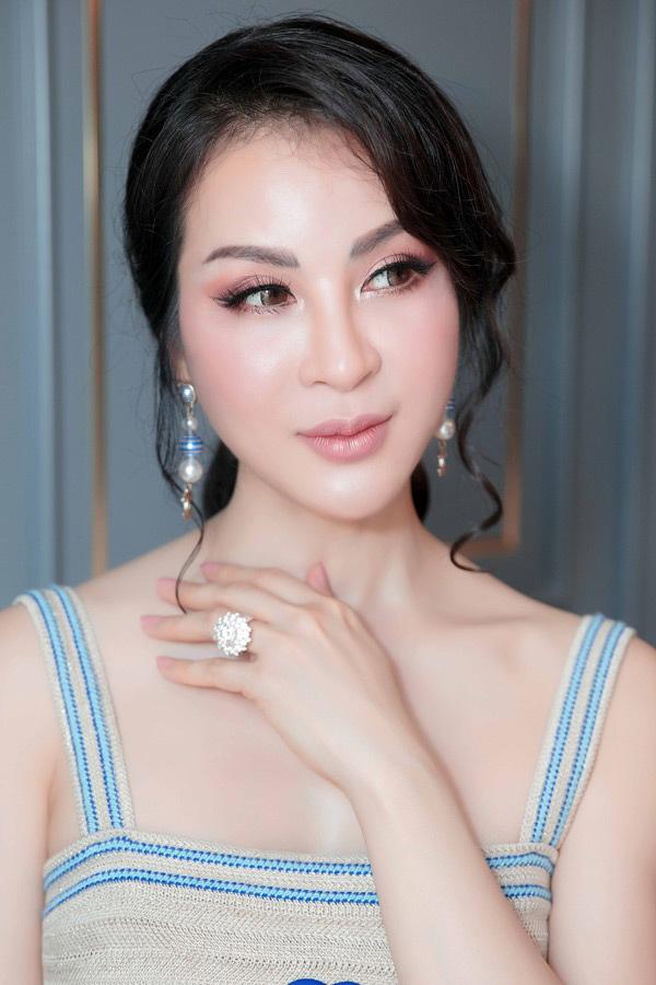"""than thai van nguoi me cua """"nhan sac khong tuoi"""" mc thanh mai tai su kien quoc te - 4"""