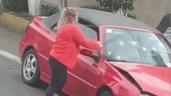 Va chạm, nữ tài xế hùng hổ cầm tuýp sắt đập phá xe đối phương