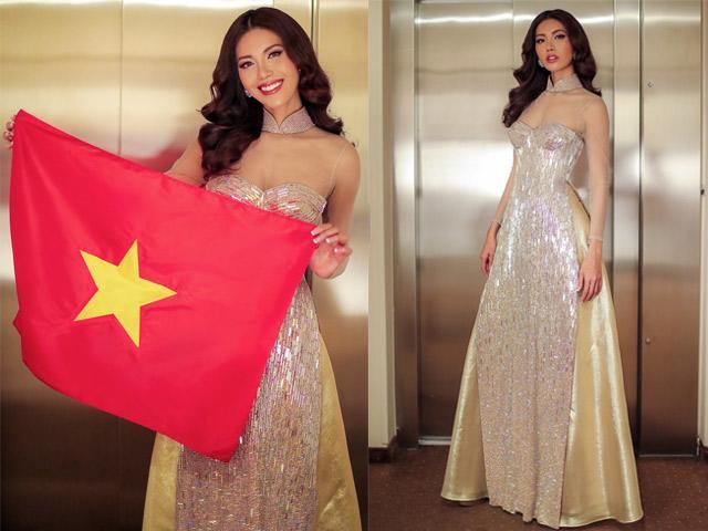 Đi thi quốc tế, Minh Tú diện áo dài xuyên thấu, cầm cờ chúc mừng Việt Nam tại AFF CUP