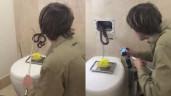 Tưởng nhà vệ sinh bị ma ám vì tự động xả nước, gia đình mở nắp phát hiện kinh hoàng