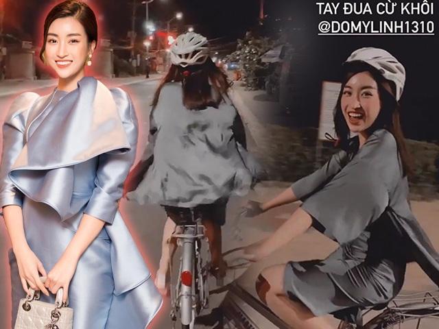 Hoa hậu nào chơi trội như Đỗ Mỹ Linh, diện váy lụa mỏng manh vẫn đi đạp xe